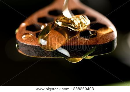 Honey Piles On Drizzler Against Dark Background