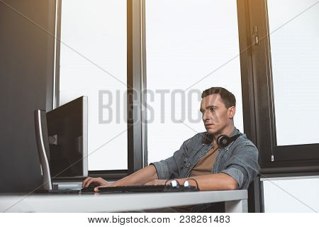 Side View Focused Programming Specialist Using Modern Computer. Interested Worker At Labor With Gadg