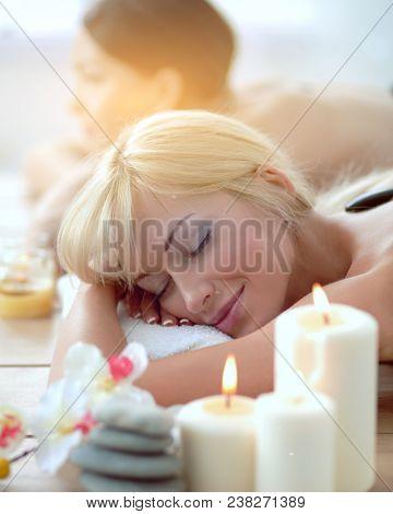 Two young beautiful women relaxing and enjoying at the spa. Two young beautiful women relaxing