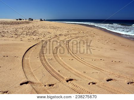 Horizontal Landscape Of The Beach With Cars. 4wd Cars At Anna Bay (nsw, Australia). Tyre Marks On An