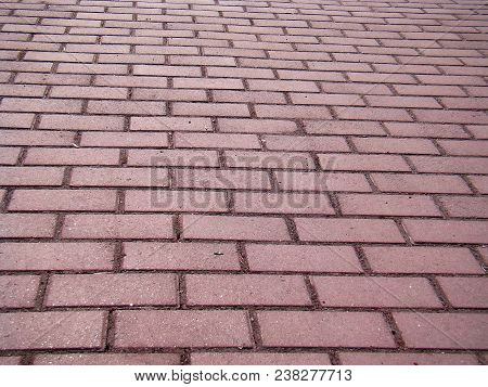Cobbled Pavement Path. The Path Is Paved With Gray Brick. A Photo.