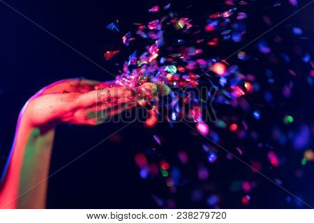 In Selective Focus Of Cheerful Young People Showered With Throwing Confetti On A Club Party.festival