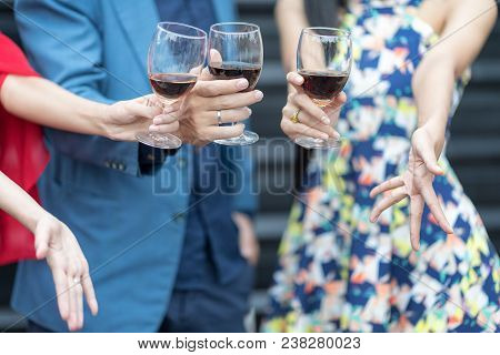 Red Wine Christmas Party Concept. Happy New Year Coming Soon.people Celebrating Happy Drinks With Fr