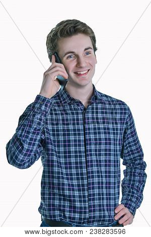 Cheerful young man speaking on the phone on white background. Pleasant conversation, conversation with a loved one, good news. poster