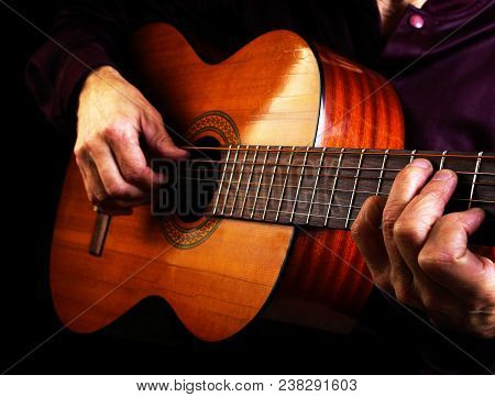 Playing An Acoustic Guitar. Closeup. Guitar Chords.