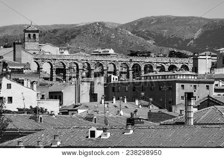 Segovia, Spain. Aerial View Of Old Town Segovia, Spain With Snowy Mountains And Old Aqueduct. Black