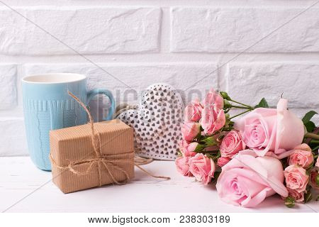Pink Roses Flowers, Decorative Heart,  Box With Present And Blue Cup On White Wooden Background. Flo