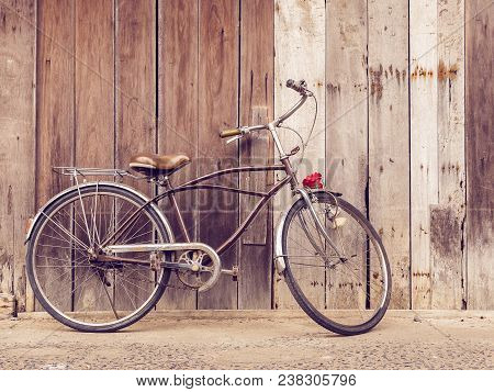 Cyclists Outdoor Lifestyle. Classic Vintage Retro Bicycle Against The Wooden Old Crack Wall At Home