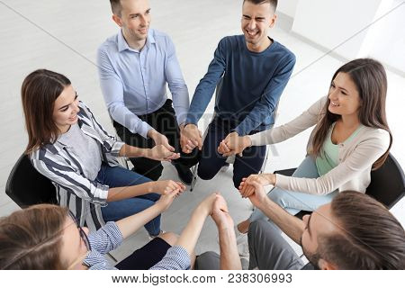 people supporting each other at group psychotherapy session