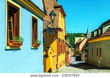 Famous Stone Paved Old Streets With Colorful Houses In Sighisoara Fortress, Transylvania, Romania, E