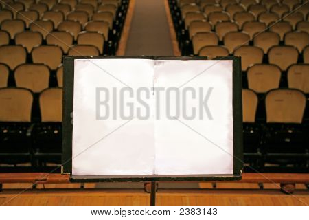 Music Stand With Empty White Paper In A Theater