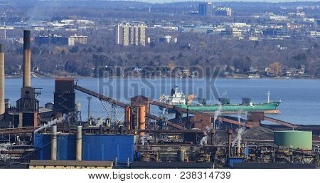 A View Of Hamilton Harbour From The Niagara Escarpment With Lake Freighter