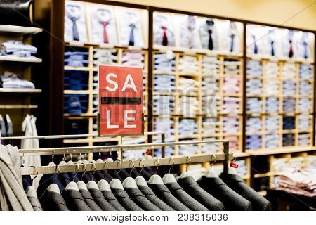 Sale Sign In Men Clothes Shop.shopping And Discount Concept. Retail Image Of A Final Sale Sign In A