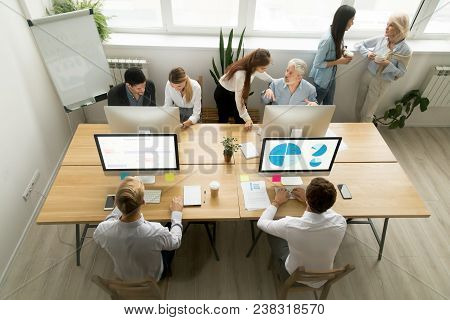 Corporate Staff Working Talking In Office Together, Diverse Young And Old Coworkers Using Computers