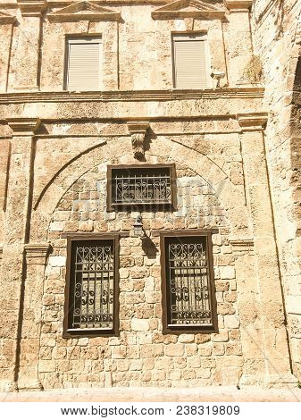 Windows Of Traditional Stoned House In Old Acre. Arab Architecture Of The Old City Of Akko In Israel