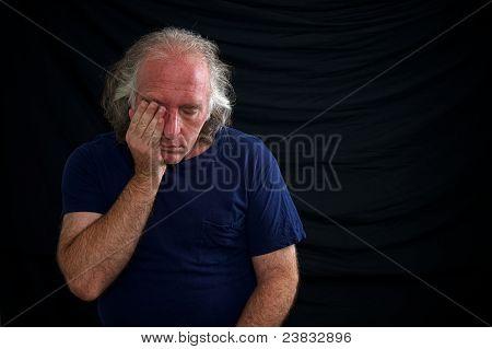 Upset Man Rubbing Eye