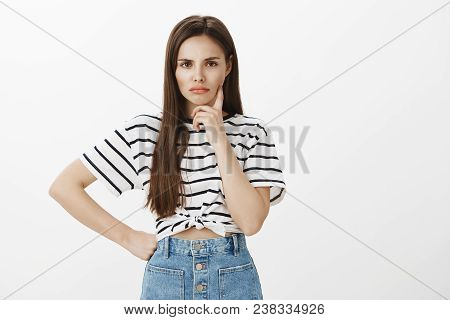 Girl Dreaming About Revenge. Portrait Of Charming Caucasian Female Student In Striped T-shirt And De