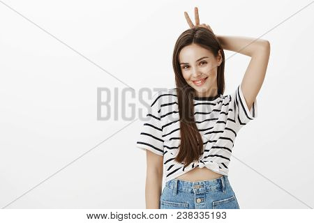 Girl Wanting To Show Boyfriend She Is In Playful Mood. Charming Feminine European Woman With Brown H