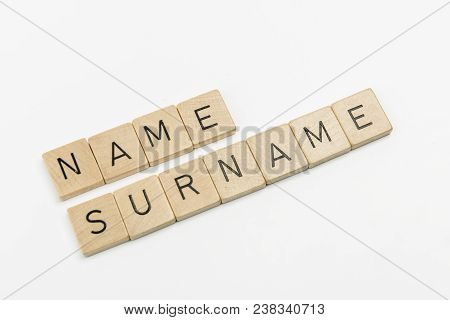 The Word Name Surname Formed With The Letters On Wooden Dowels