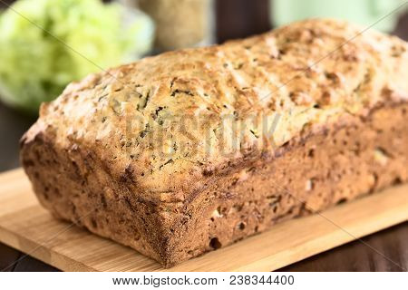 Loaf Of Fresh Homemade Zucchini And Walnut Quick Bread On Wooden Cutting Board (selective Focus, Foc