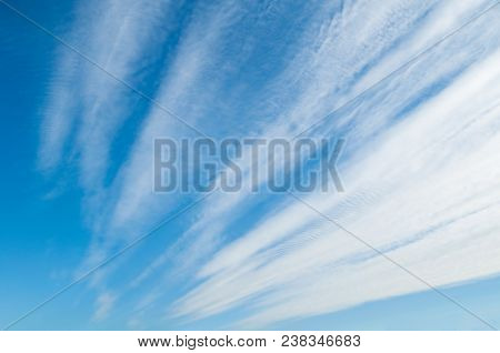 Blue Sky Colorful Landscape With White Evening Sky Clouds Lit By Sunlight. Sky Landscape Scene, Blue
