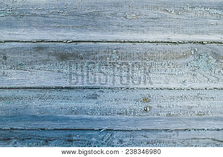 Textured Wooden Background Of Wooden Weathered Planks Covered With Old Peeling Paint Of Blue Color.
