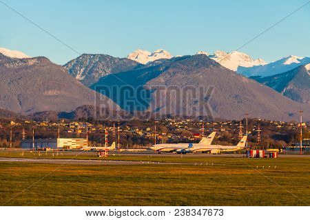 The Airdrome Of Sochi International Airport With Planes On The Background Of Mountains In Sunny Day,