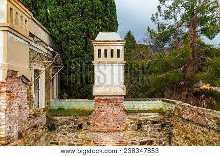 Chimney Of Abandoned Old Mansion Called Dacha Kvitko Among The Thicket In Overcast Day, Sochi, Russi