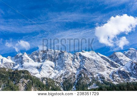 View To The Great Snowcapped Mountains Of The Bavarian Alps In Germany. Close-up Of Beautiful White