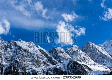 View To The Great Snowcapped Mountains Of The Bavarian Alps In Germany. Close-up Of The Beautiful Wh