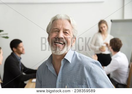 Happy Senior Businessman Laughing Looking At Camera In Office, Cheerful Team Leader Posing With Empl