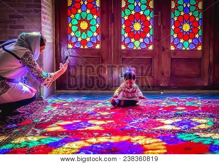 Shiraz, Iran - October 23, 2016: Iranian Woman Takes Photo Of Baby In Nasir Ol Molk Mosque Also Know