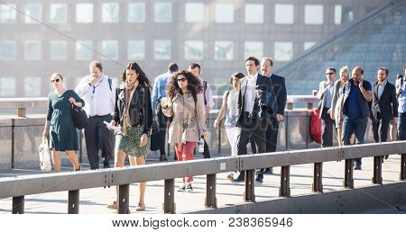London, Uk - April 19, 2018: Blurred Image Of Office Workers Crossing The London Bridge In Early Mor