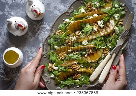 Salad With Arugula Blue Cheese Walnuts And Pear Grilled