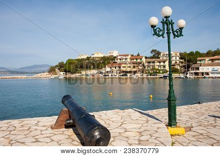 Kassiopi Port In Corfu With A Cannon In Greece