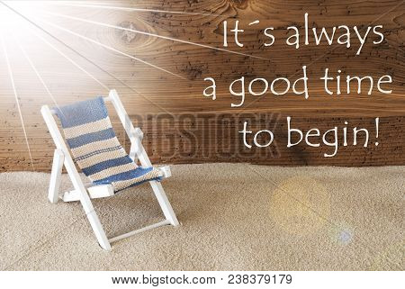 Sunny Summer Greeting Card With Sand And Aged Wooden Background. English Quote It Is Alwyas A Good T