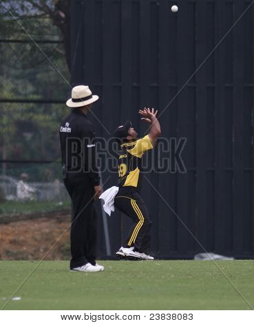 PUCHONG, MALAYSIA - SEPT 24: Malaysia's Hammad Khan prepares to catch and claim a wicket against Guernsey in this Pepsi ICC WCL Div 6 finals in Kinrara Oval on September 24, 2011 in Puchong, Malaysia.