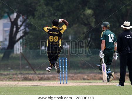 PUCHONG, MALAYSIA - SEPT 24: Malaysia's Hammad Khan goes airborne to bowl in this Pepsi ICC World Cricket League Div 6 finals vs Guernsey at the Kinrara Oval on Sept 24, 2011 in Puchong, Malaysia.
