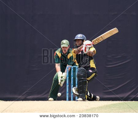 PUCHONG, MALAYSIA - SEPT 24: Guernsey's Tom Kimber watches Malaysia's Mohd Shafiq bat in this Pepsi ICC World Cricket League Div 6 finals on September 24, 2011 at the Kinrara Oval, Puchong, Malaysia.