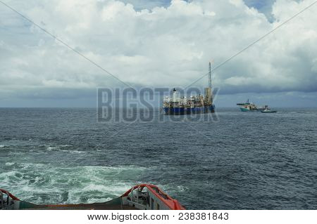 Anchor-handling Tug Supply Ahts Vessel During Dynamic Positioning Dp Operations With Fpso Tanker. Ve