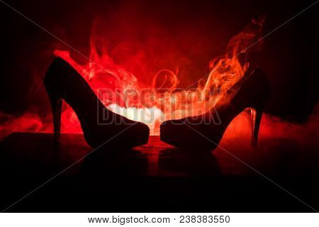 Black Suede High Heel Women Shoes On Dark Toned Foggy Background. Close Up. Women Power Or Women Dom