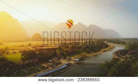 Aerial View By Drone : Hot Air Balloon Over Nam Song River In Vang Vieng, Laos On Sunset, Vintage To