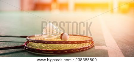 Badminton Ball (shuttlecock) And Racket On Court Floor Banner Panoramic Crop For Copy Space. Badmint