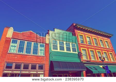 A Vintage View Of Old Downtown Facade Buildings In Smithfield, North Carolina Under A Blue Sky.