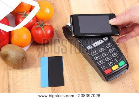 Payment Terminal With Mobile Phone With Nfc Technology And Credit Card, Fruits And Vegetables In Sho