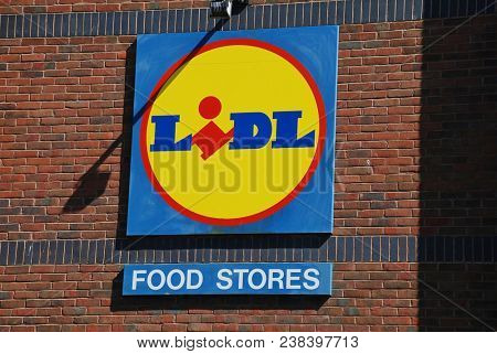 FOLKESTONE, ENGLAND - JULY 6, 2008: Signage outside a branch of German supermarket chain Lidl. Operating throughout Europe, Lidl is known for its discounted prices.