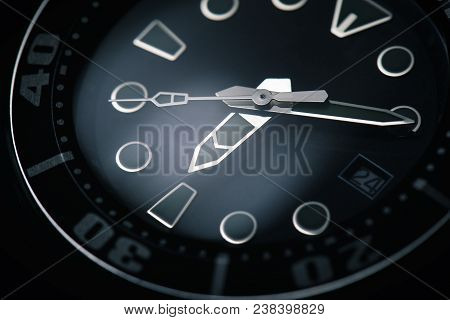 Macro Of Black Watch With Silver Clock Hands