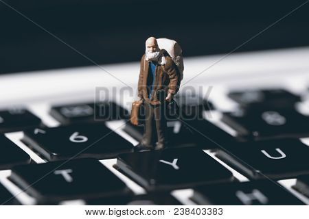 Tiny Man And White Notebook Keyboard. Computer Keyboard Closeup With Focus On Y Button. Press Yes In