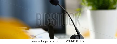 Empty Remote Office Workplace With Laptop Pc And Headset Closeup. Receptionist Or Secretary Of Conta