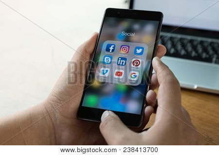 Chiang Mai, Thailand - Mar 28, 2018: Man Holding Huawei With Icons Of Social Media On Screen. Social